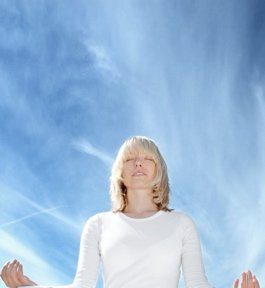 Lady Meditating in Blue Sky